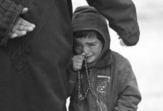 A boy, standing next to his father, cries as they wait to receive humanitarian aid in the countryside of Idlib, Syria. In the capital Damasc. Children Of Syria, Syrian Children, Save Syria, Help Syria, World Poverty, Syrian Civil War, Rain Jacket, Bomber Jacket, Earthquake And Tsunami