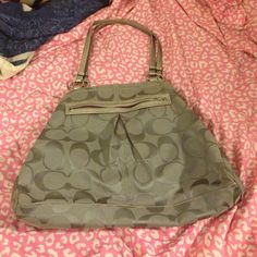 Coach purse It is a large bag that you could wear two ways as shown. There is a little spot on the back of the back that you can only see in the lighting. There is VERY slight wear on the bottom corners of the bag. The inside of the bag is in perfect condition. It is a silver/grey bag- free gift with purchase Coach Bags