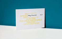 Fashion week S/S 2014 invitations: Jil Sander: Repeating the format from seasons past, Jil Sander's robust card reflected the brand's minimalist aesthetic. The type embossed on the back gave the illusion that the text had been pushed through the card and was printed in lemon sorbet yellow foil on the front