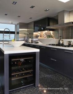 modern kitchen with strategic lighting plan for the host of activities that will ensue www
