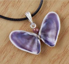 Purple and White Striped Natural Butterfly Shell Necklace on Adjustable Black Cord. $9.00, via Etsy.