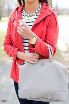 Jacket. Striped shirt, necklace.