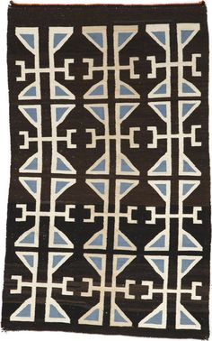 A Navajo Teec Nos Pos rug  An unusual example with three rows of typical border motifs dominating the field.  size approximately 4ft 2in x 2ft 8in