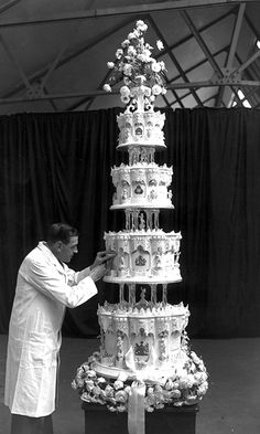 The wedding reception was held at Buckingham Palace where guests were presented with posies of white heather and myrtle as favors. The wedding cake was a grand affair, standing 9ft high, weighing 500lbs and featuring four tiers. Made from ingredients received from the Australian Girl Guides, the cake was cut using Philip's sword. One layer was kept until the christening of Prince Charles and another was sent back to Australia as a thank you.    Photo: Getty Images