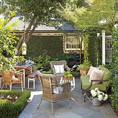 Olivia Brock's garden seems like an outdoor family room. It stay conected to the kitchen by french doors.