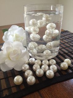 20 pieces of Jumbo Size 24mm Pearls For Used in Floating Pearl Centerpiece as shown inside per vase. Pearls also have a small hole for easy stringing. Select from the drop down menu your choice of col