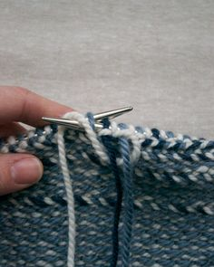 Laura's Loop: ArcticWrap.  Pictorial tutorial on how to carry the yarn across the back when working with three strands.