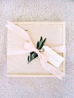 Pretty welcome box: http://www.stylemepretty.com/maryland-weddings/bethesda-maryland/2016/05/20/a-greek-inspired-affair-complete-with-an-olive-oil-bar/ | Photography: Abby Jiu - http://www.abbyjiu.com/