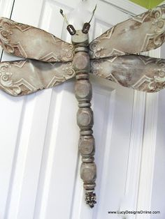 Made from fan blades, chair leg, drawer pulls, double-sided screw hook
