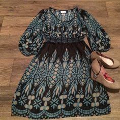 3/4 length sleeve dress Sheer overlay with lining. Black, tan and a really pretty shade of blue. Waist and arm bands have elastic. Hits at knee or just above. Very comfortable and light weight. Emmelee Dresses Long Sleeve