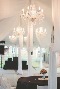 Black-and-White Reception With Crystal Chandeliers | Once Upon A Click https://www.theknot.com/marketplace/once-upon-a-click-calera-al-871693 | Rosewood |