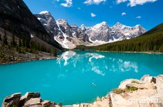 Dream Vacation-Lake Louis in Canada-one of the top 10 most beautiful places in the world. The color of lakes in Banff area is unbelievable. Just like you dropped a color paint into water