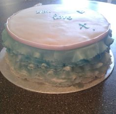 Pretty blue ombre frill cake finished with a light pink ribbon and an edible shimmer spray to add a little shine to it. :)