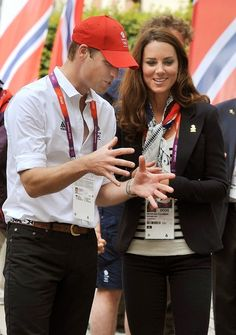 LONDON, ENGLAND - JULY 31:  Prince William, Duke of Cambridge and Catherine, Duchess of Cambridge during a visit to the Team GB accommodation flats in the Athletes Village at the Olympic Park in Stratford on Day 4 of the London 2012 Olympic Games on July 31, 2012 in London, England.