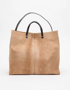 The sophisticated tan tote bag by Clare Vivier, crafted from the softest milled leather and rich eco-friendly dyes.