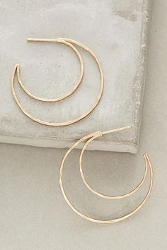 Anthropologie Curved Crescent Hoops #fashion #style