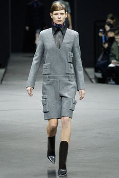 Alexander Wang goes WWI in his Fall 2014 RTW collection! This thick grey wool jumpsuit is very utilitarian in structure. It is not very fitted or body clinging, which is common in most garments from WWI. It also has big pockets to hold things and seems very useful for war times. Uniforms also became daywear during WWI and this outfit definitely has a uniform feel! I'm not sure if I would wear this, but it has a very military, WWI feel.