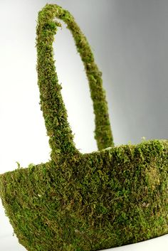 Moss Covered Basket - buy or DIY with moss graffiti recipe found here on pinterest and use in garden.