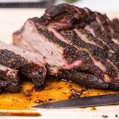 """""""Marinated Brisket. This brisket has won multiple awards and a fan favorite. So easy and perfect every time!! . Prep time: 10 minutes Cook time: 12 hours Serves: 10 people . Ingredients(Marinade): 1/3 cup apple cider vinegar 1/3 cup olive oil 1 cup fresh cilantro, chopped 6 cloves garlic, minced juice of 4 limes juice of 1 lemon 2 tablespoons cumin 1 tablespoon black peppercorns 1 tablespoon dried oregano 1 teaspoon salt Rub 3 tablespoons black pepper 3 tablespoons cumin"""