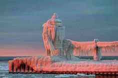 Frozen light house lake michigan.