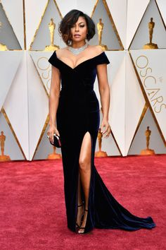 Taraji P. Henson served up some serious leg with this velvet Alberta Ferretti gown featuring an off the shoulder neckline and thigh high slit. She topped off the look with a messy lob and stunning diamonds.