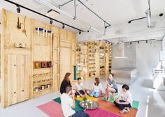 Parisian cooking classroom tools pack away onto plywood wall