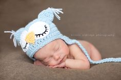 Newborn in an owl knitted hat