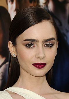 Lily Collins at the LA premiere of The Mortal Instruments: City of Bones rocking deep burgundy lipstick + bold brows.
