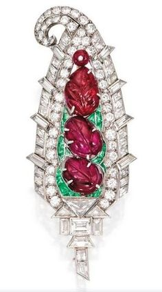 Diamond, Ruby and Carved Emerald Brooch Mauboussin, 1930 Sotheby's by shawna