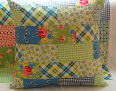 patchwork pillow. No pattern but I have to make one like this to go with the quilt I just made. ~ nice combination and usage of print fabrics, colors