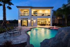 """in Kissimmee, US. 9-Bedroom, 9.5-Bathroom, 6,000sf Luxury Vacation Home in Reunion Resort, sleeps 22 Guests, includes Private Pool with Heated Spillover Spa & Rock Grotto Waterfall, Home Theater with 106"""" Screen & Stadium Seating for 13, Indoor/Outdoor Game Room, C..."""