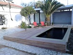 Piscine semi enterr e bois et pierre piscine pinterest for Piscine bois montana