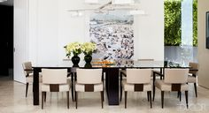 The photograph in this Los Angeles dining area is by Massimo Vitali.