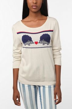 I want this hedgehog sweater so bad.  I saw it at urban outfitters and was waiting for it to go on sale, but instead they sold out everywhere!  Who knew there were so many hedgehog lovers!