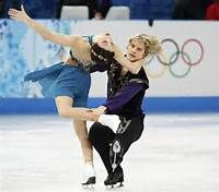 Meryl Davis and Charlie White of the United States figure skating team compete during the Team Ice Dance Free Dance at the Sochi 2014 Winter Olympics, February 9, 2014. REUTERS/Lucy Nicholson