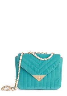 Aqua/teal velvet quilted crossbody bag with light gold hardware and white leather laced chain strap.