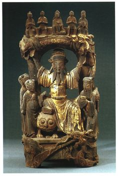 Wooden statue of Sun Simiao as the Medicine God, seated on a tiger and holding a dragon above him