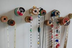 Necklace storage from old wooden spools.