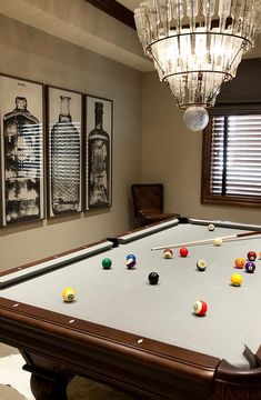 Billiards room with gorgeous stained glass panel from property fantastic games room features a tiered glass bottles chandelier arteriors stedman 5 light iron glass chandelier hanging over a pool table greentooth Gallery