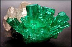 Emerald- (Beyrl)- composed of beryllium aluminium cyclosilicate. Colored green by trace amounts of chromium and sometimes vanadium, hardness of Crystal system Hexagonal Minerals And Gemstones, Rocks And Minerals, Crystal System, Emerald Gemstone, Raw Emerald, Natural Emerald, Emerald Green, Green Gem, Emerald City