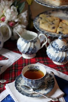A cozy Tea with scones, transferware, plaid cloth, linen napkins, silver and, of course, flowers.