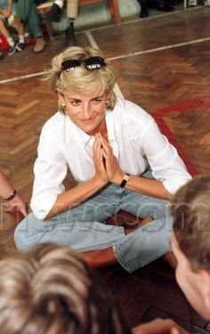 August 9, 1997: Diana, Princess of Wales, at a volleyball match in Zenica, Bosnia, played entirely by victims of landmines.