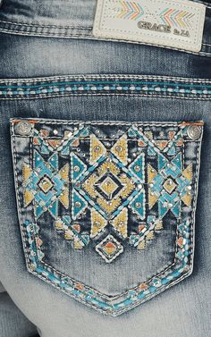 Grace in LA Women's Light Wash with Blue, Yellow, and Orange Aztec Embroidery Open Back Pocket Shorts | Cavender's