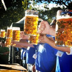 Flex those beer muscles at Oktoberfest stein-holding competitions - fun beer Olympic idea that doesn't involve chugging a beer