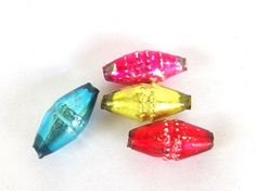 Four vintage multicolored mercury glass beads are diamond shaped. Use these textured beads as a focal point for your icicle creations