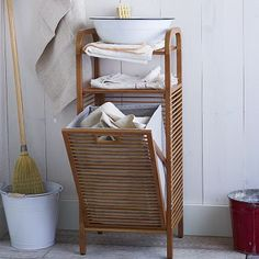 Love how this keeps the actual hamper part out of sight, and provides shelves for other storage/display  Bamboo Laundry Hamper - Ritz #WestElm