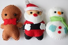 (Jumping the gun a bit -- but if I start now in March, maybe I can make these suckers by Christmastime.)  Felt Plush Ornaments Santa Claus, Snowman & Gingerbread Man - Set of 3 / Includes Ribbon for Free. $30.00, via Etsy.