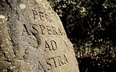 "Per aspera ad astra - Latin translation: ""Though hardships to the stars"". Hardships take you to the stars."
