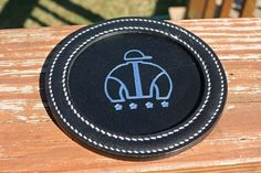 For someone on my gift list:  Round Embossed Coasters – Hill Top Leather Shop