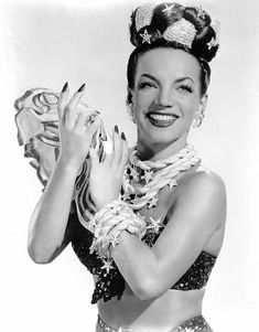 Carmen Miranda, Soundtrack: Radio Days. Carmen Miranda was born Maria do Carmo Miranda da Cunha on February 9, 1909, near Porto, Portugal, in the town of Marco de Canavezes. Not long after her birth her family moved to Brazil, where her father was involved in the produce business. The family settled in the then-capital city of Rio de Janeiro. After leaving school, Carmen got a job at a local store, and often began singing on the job. ...